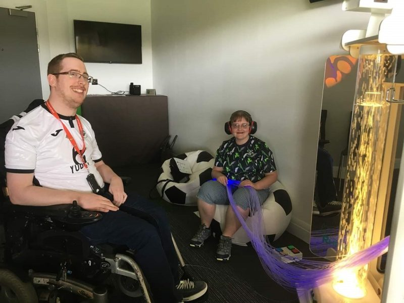 Swansea City fans enjoying the new sensory room at the Liberty Stadium