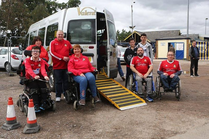 Kerry Evans helps to introduce accesible travel for Wrexhams disabled away supporters.